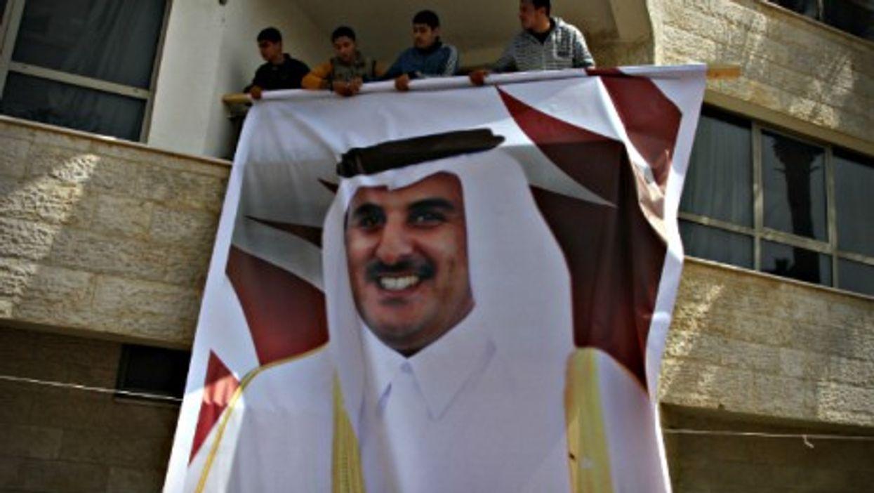 Supporters of Qatar's Emir Sheik Hamad bin Khalifa Al Thani in Gaza