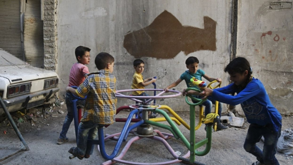 Syrian children playing in Al-Ghouta, Damascus