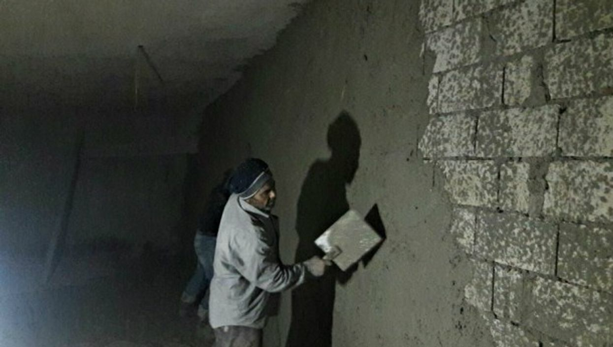 Syrian man helping build the Avicenna Women & Children's Hospital