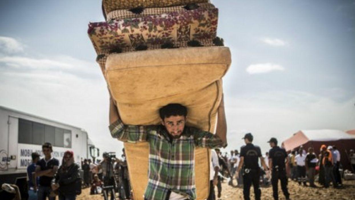 Syrian refugees entering Turkey earlier this week.