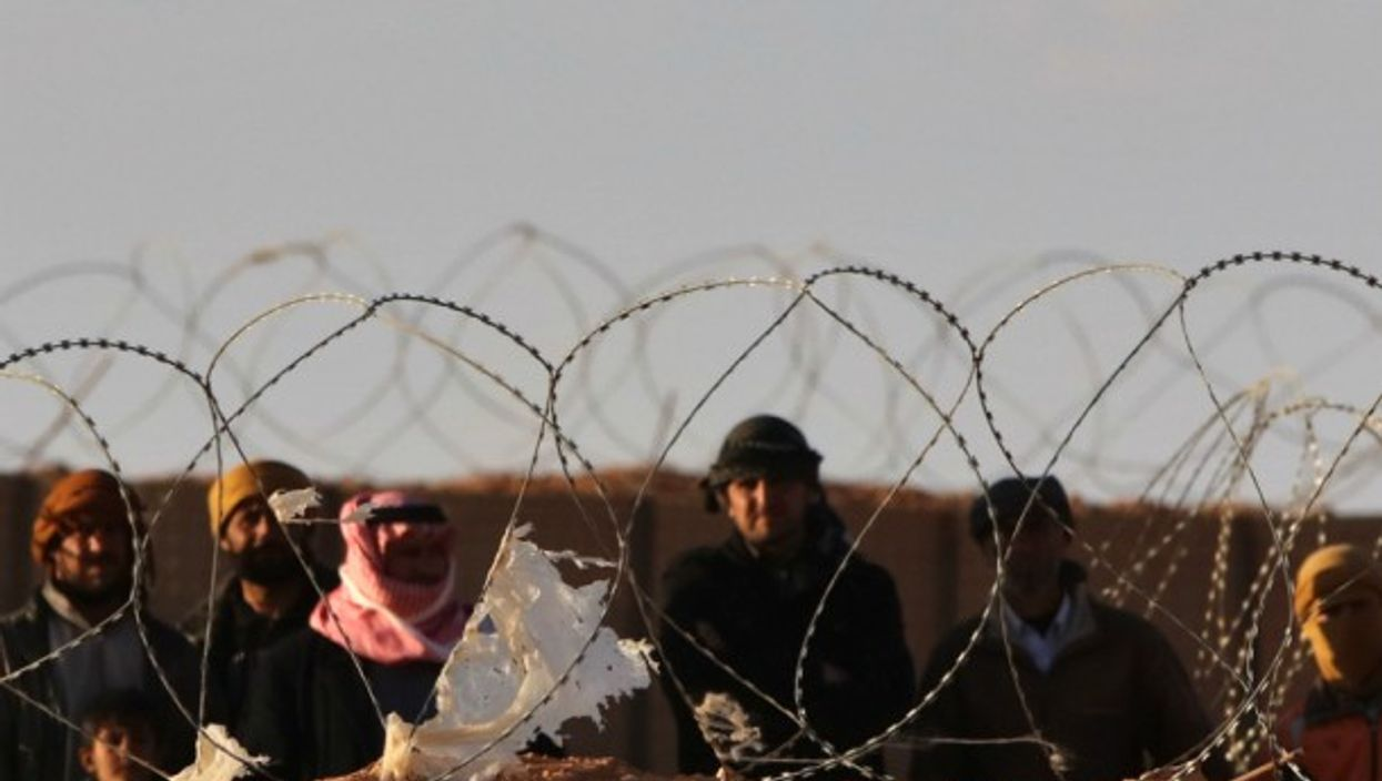 Syrian refugees on the border between Syria and Jordan