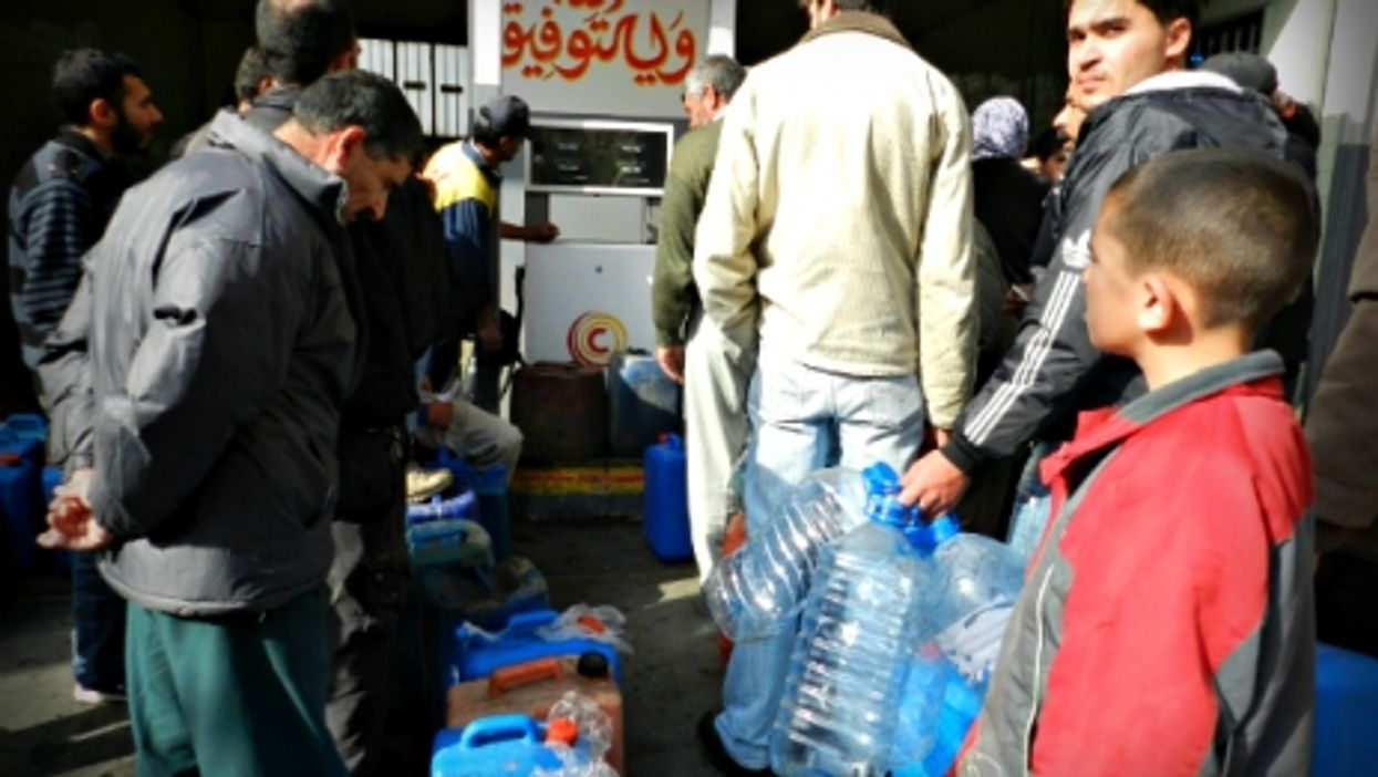 Syrian refugees queuing for gas in southern Lebanon