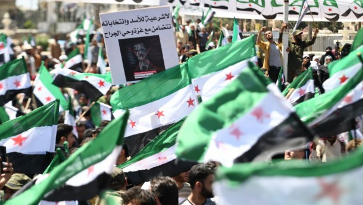 Syrians demonstrated in the city of Idlib against the presidential elections which were held this Wednesday, with Bashar al-Assad expected to win a fourth term