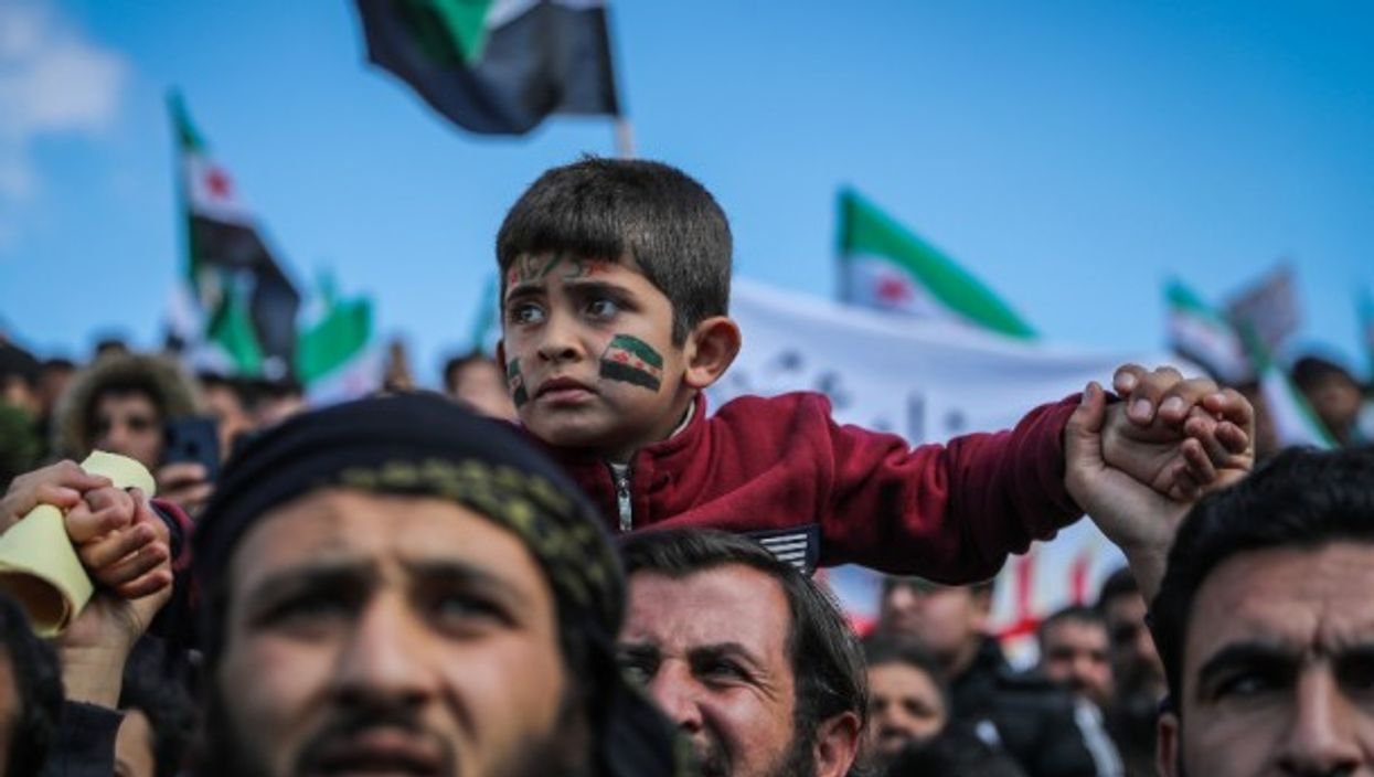 Syrians in the city of Idlib celebrate the 10th anniversary of the Syrian revolution against the regime of leader Bashar al-Assad.