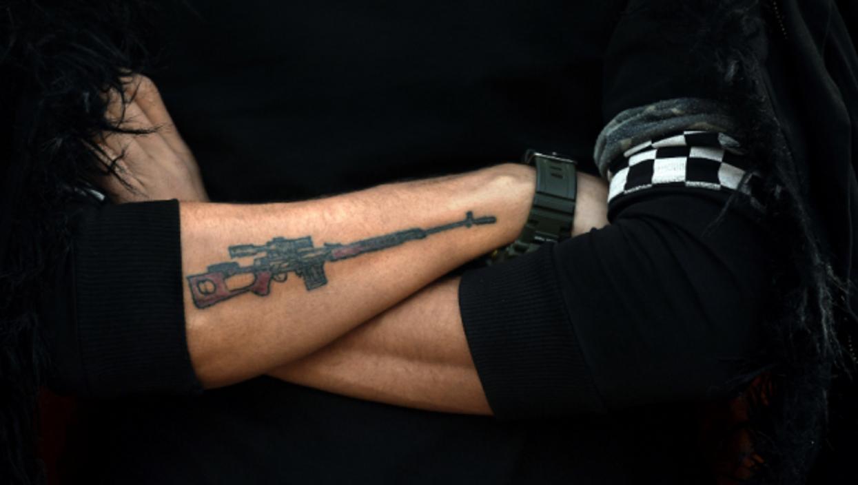 Tattooed fighter in Qandil, Iraq