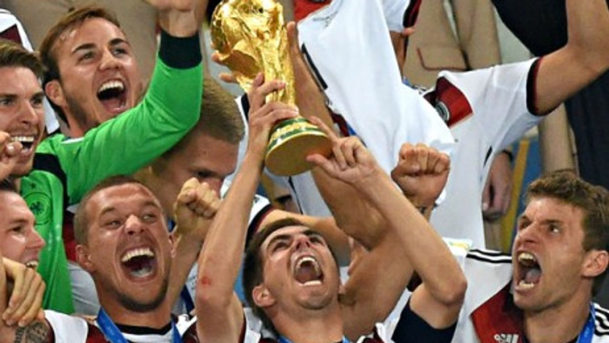 Team captain Philipp Lahm lifts up the World Cup trophy after winning the FIFA World Cup 2014 final soccer game.
