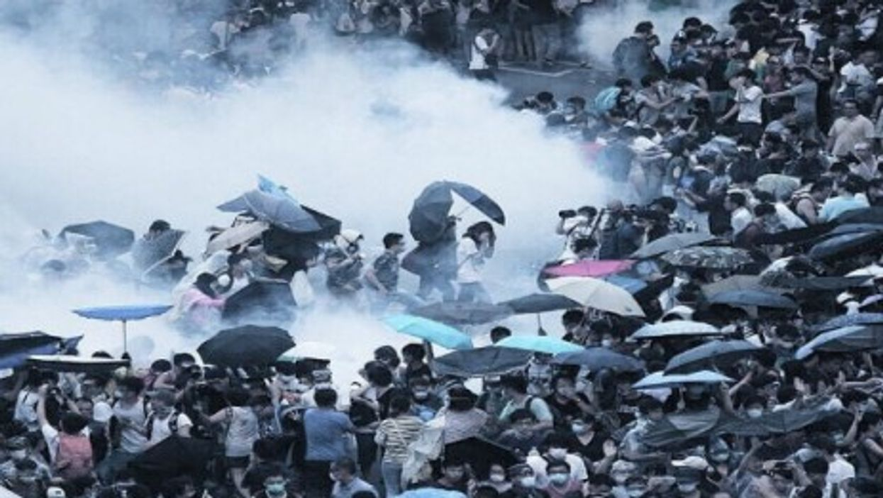 Tear gas and pepper spray fired at demonstrators during a pro-democracy protest in Hong Kong