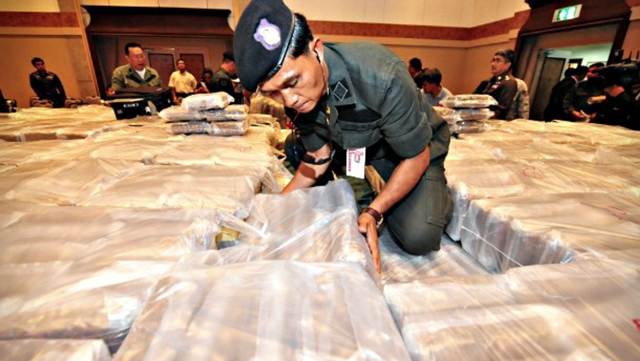 Thai police officer and seized drugs at the police HQ in Bangkok