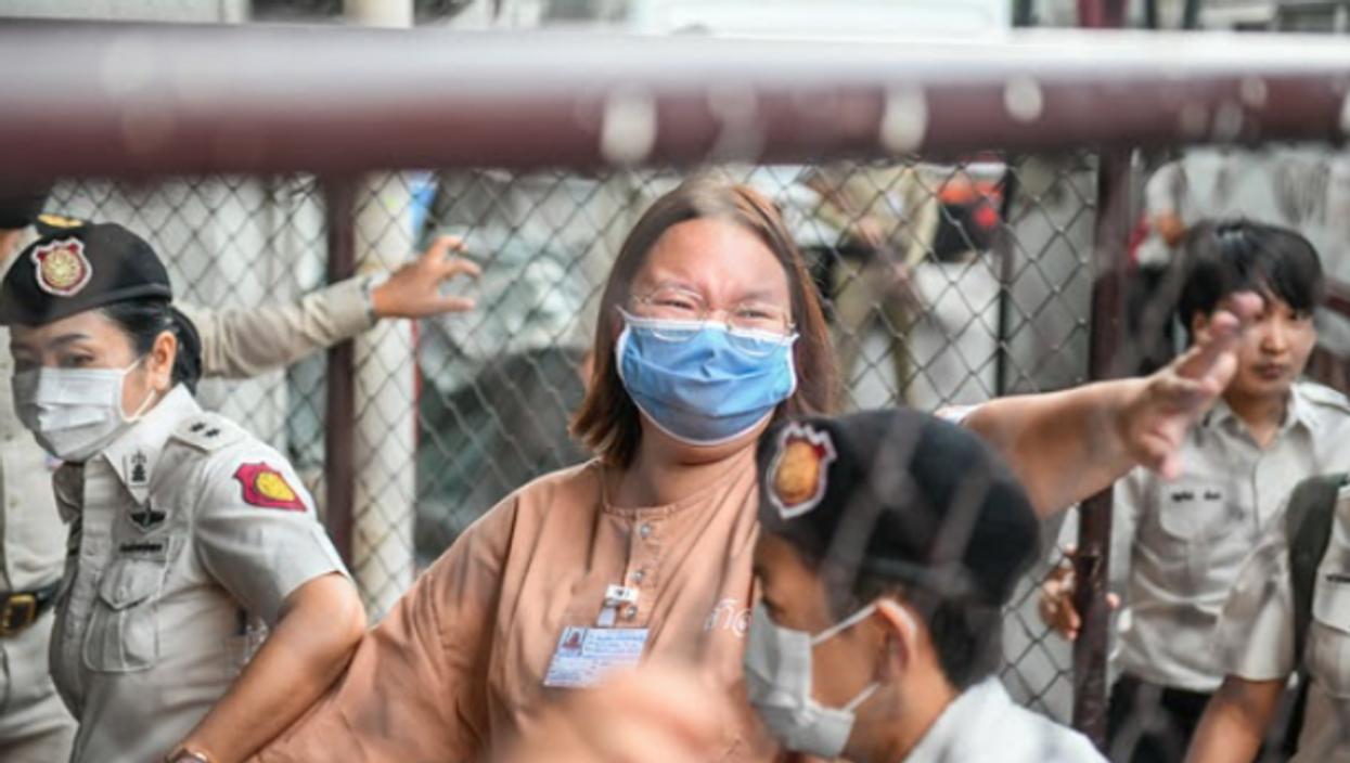 Thai pro-democracy activist Panusaya Sithijirawattanakularrives arrives in Bangkok to face trial for royal defamation.