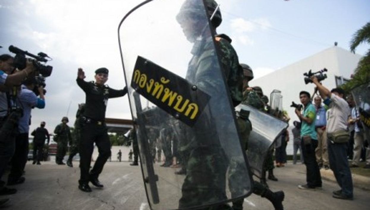 Thailand's military held firm Friday, a day after suspending the constitution and taking power.