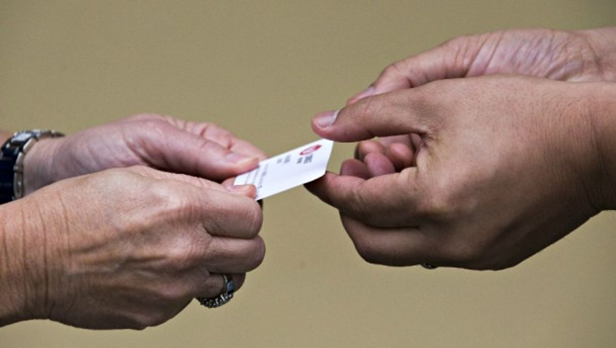 The Chinese two-handed method of presenting a business card