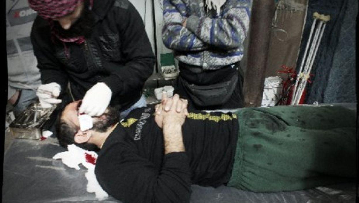 The dark, damp emergency room in the field hospital of besieged Homs