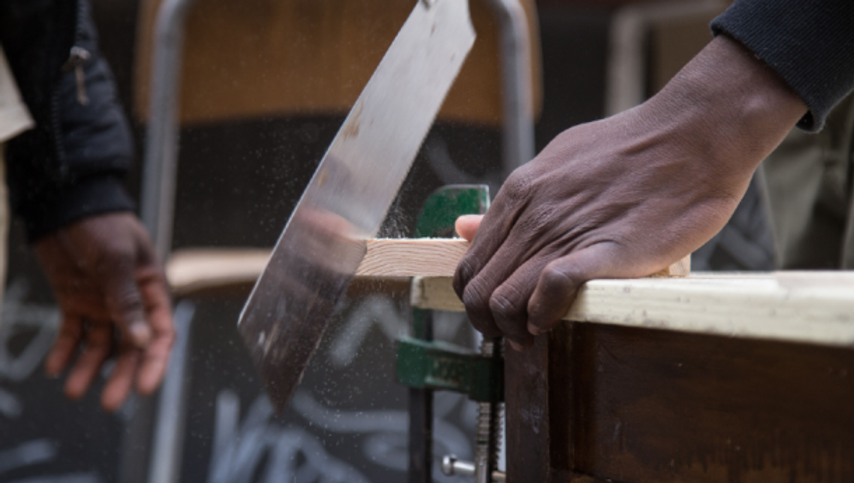 The non-profit organization ''ALI - Free Home Reception'' is hosted by some young migrants from the K_Alma Social Carpentry workshop to build wooden houses and wooden objects.