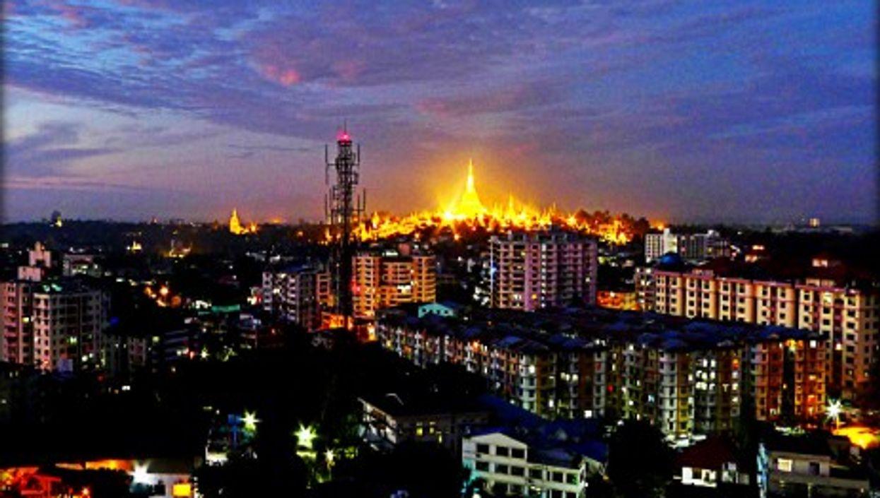 The Shwedagon pagoda dominating the skyline of Rangoon