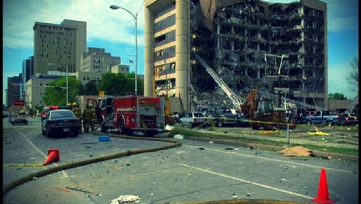 The smoldering ruin of the Murrow Building in Oklahoma City in April 1995