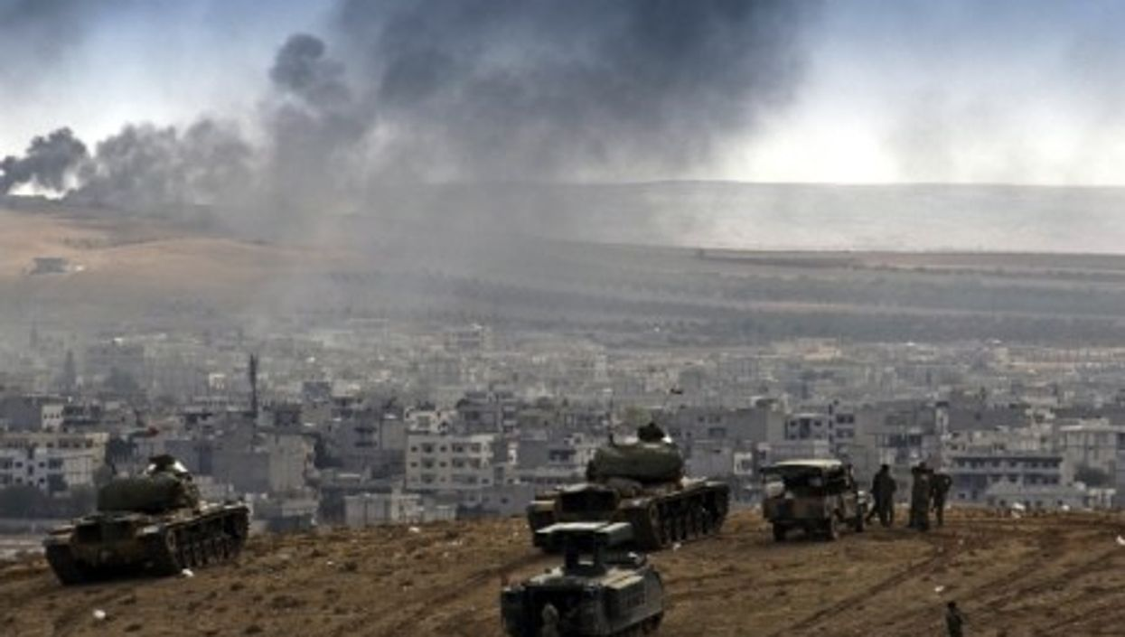 The Turkish military watches the battle in Kobane.
