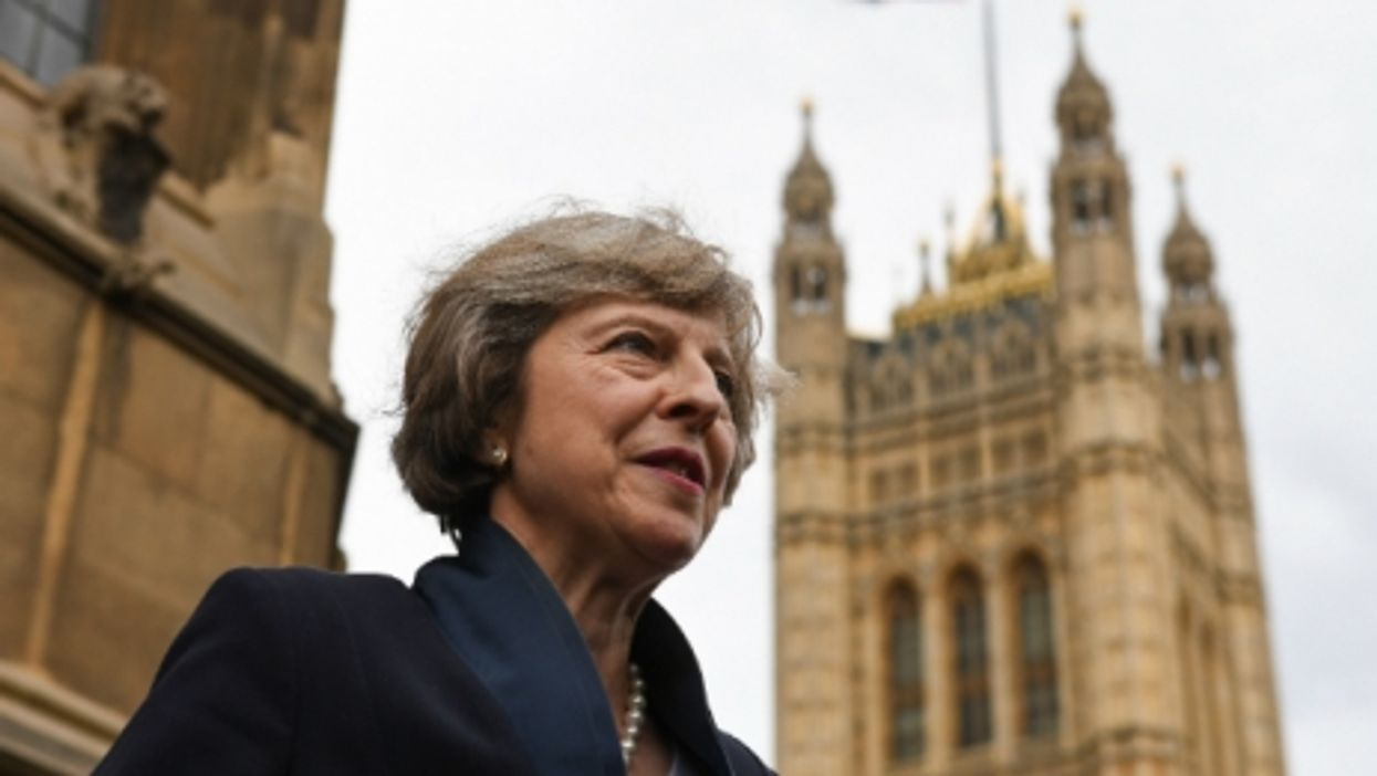 Theresa May outside the House of Commons.