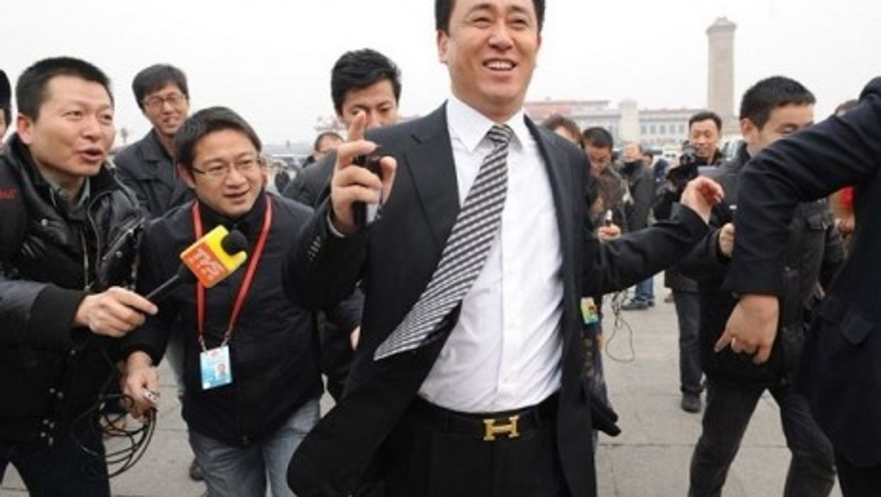 This image of the head of one of China's top real estate holdings flashing his Hermes belt lit up the Chinese Internet.