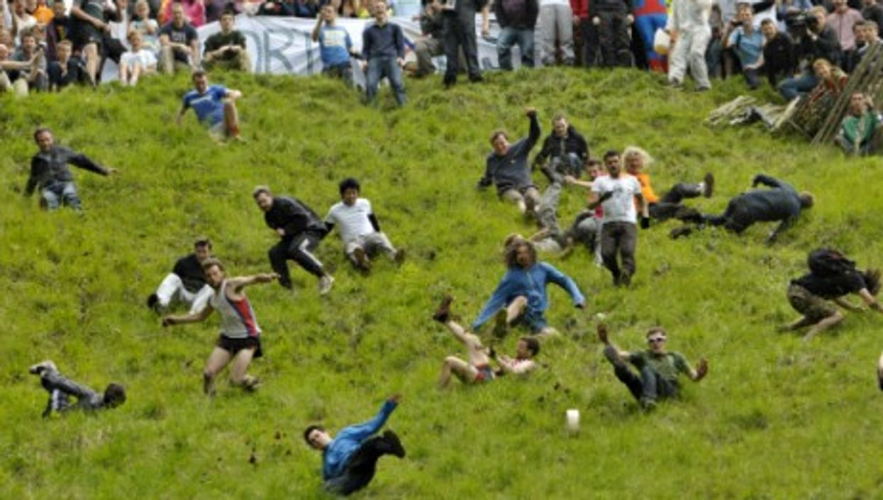 Thousands gathered Monday in Brockworth, UK, for the annual cheese-rolling competition down Cooper's Hill.