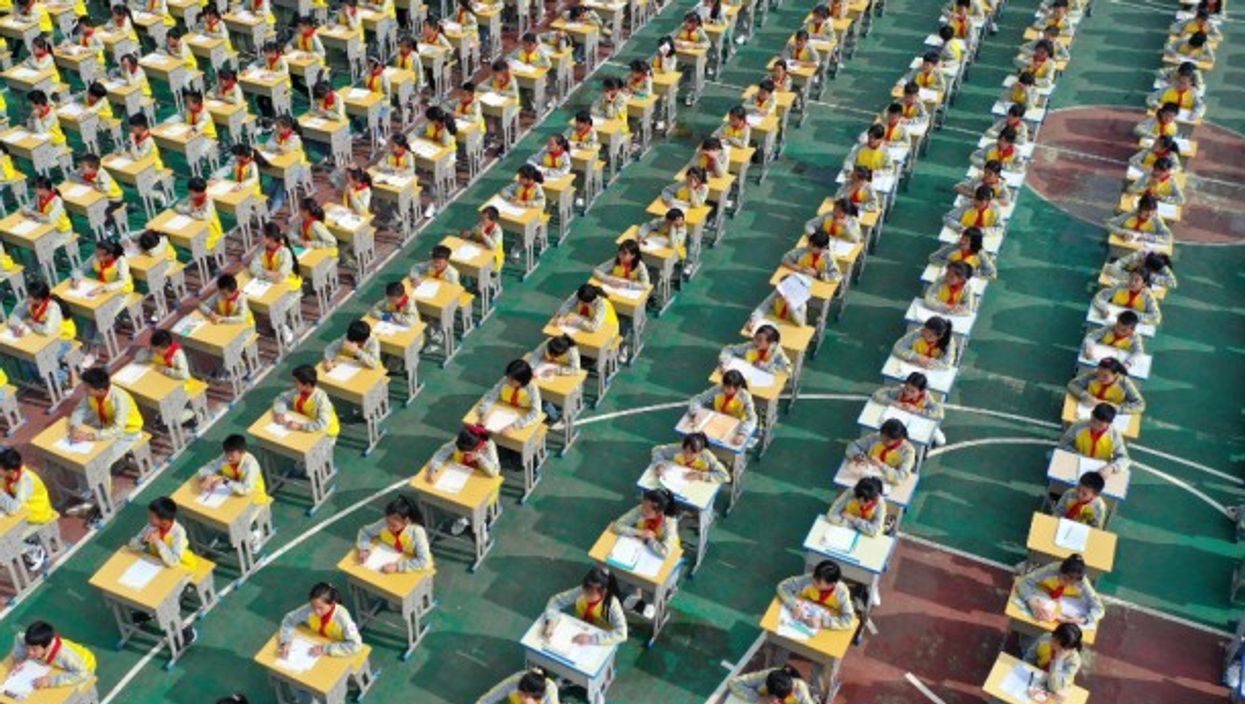 Thousands of schoolchildren participate in a calligraphy competition in Anlong, China