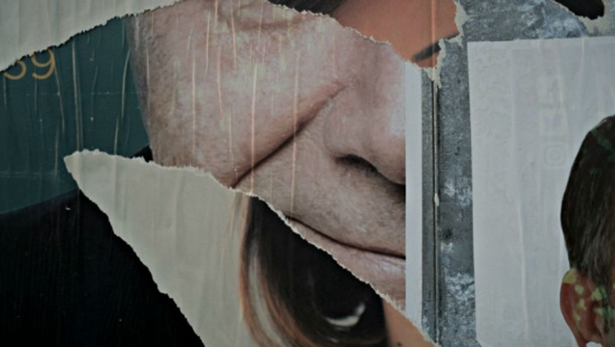 Torn election posters in Naples on March 2