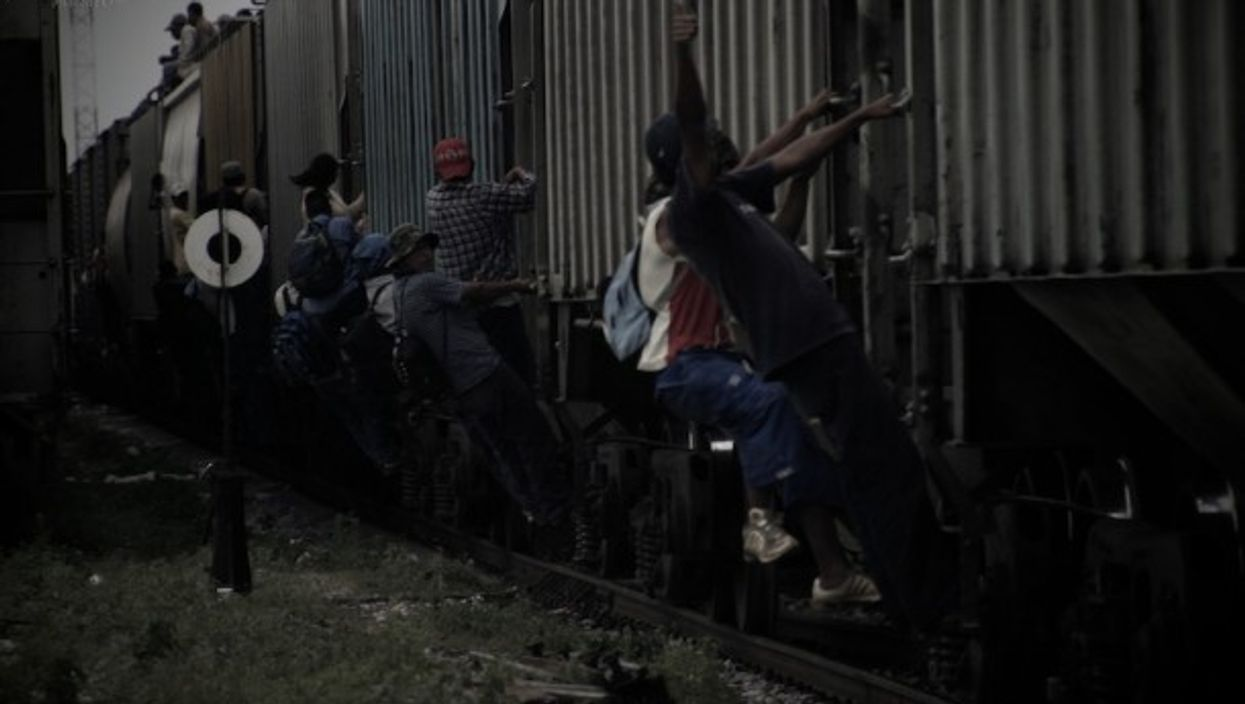 Train surfing migrants in Mexico