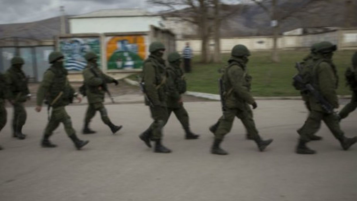 Troops believed to be from Russia on the march in Crimea.