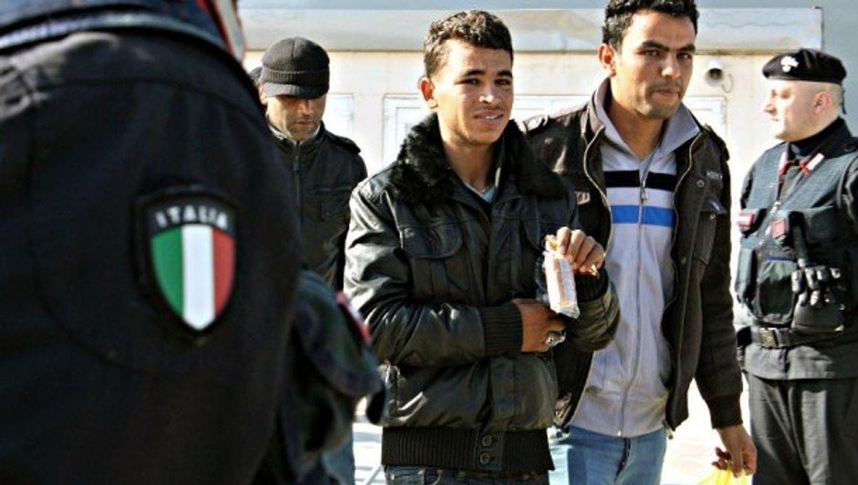 Tunisian migrants arriving in Lampedusa