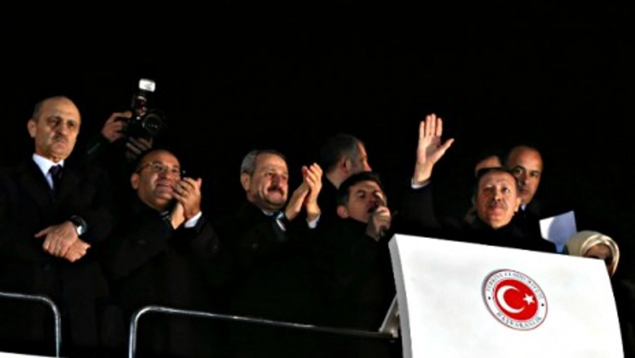Turkish PM Recep Tayyip Erdogan (waving) and other AKP party members on Dec. 24