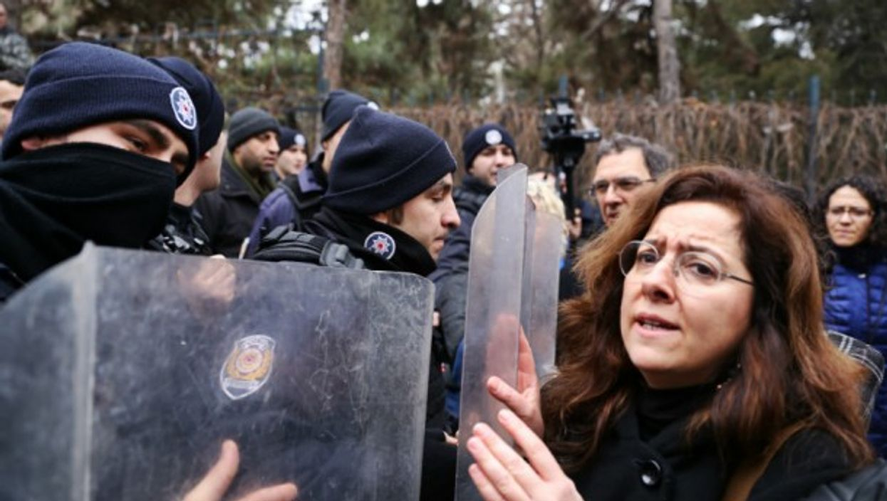 Turkish police restrain demonstrators on Feb. 10