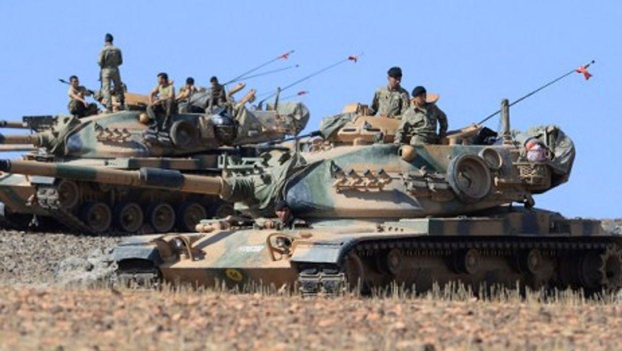 Turkish tanks take up position on the Turkish - Syrian border at Suruc, Turkey.