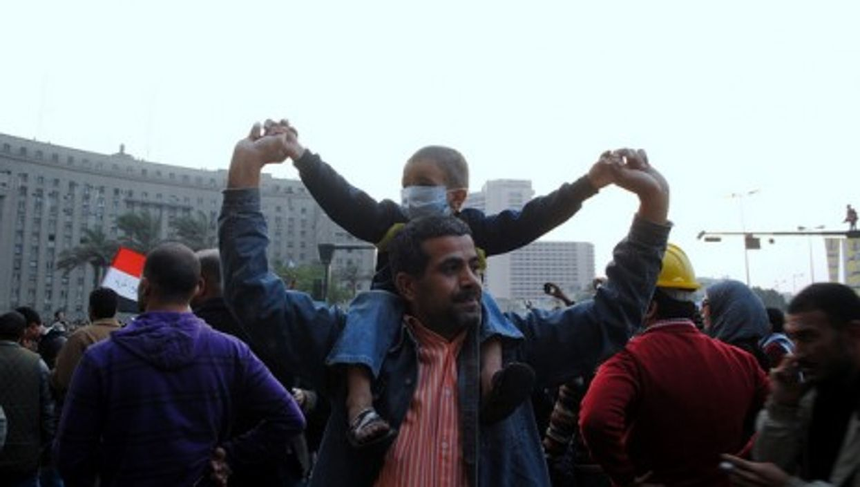 Two protesters in Tahrir Square on Monday (lilianwagdy)