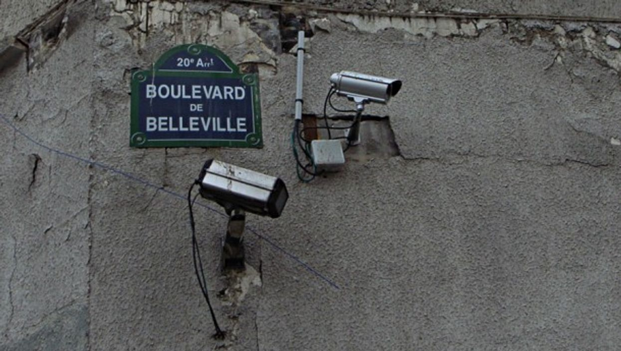 Two security cameras on a French street corner