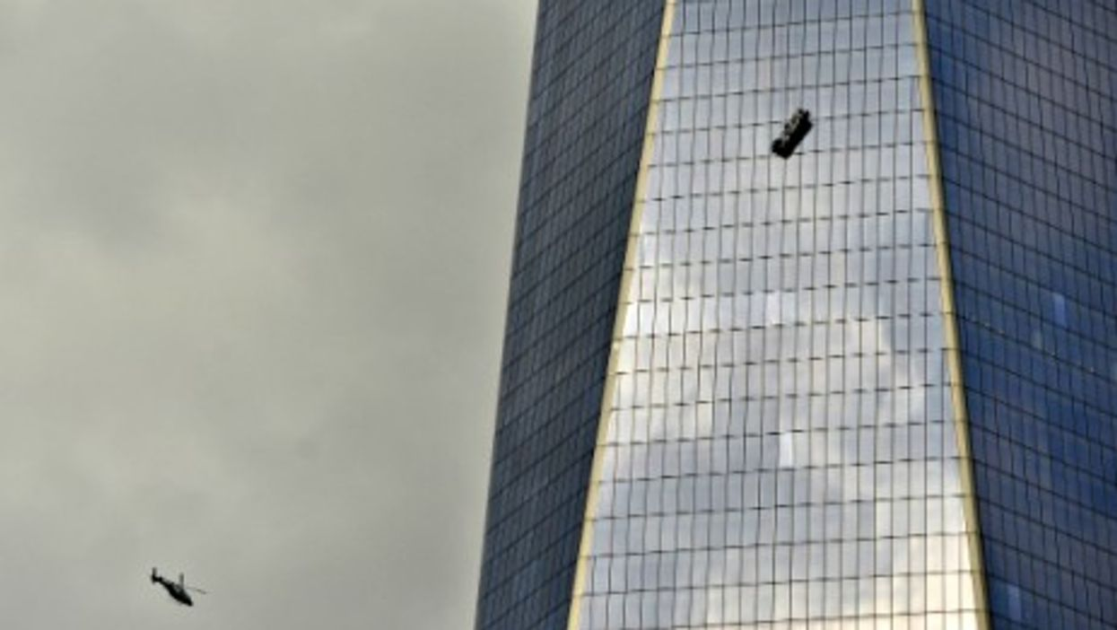 Two window washers were left dangling for almost two hours from the 69th floor of One World Trade Center Wednesday afternoon.