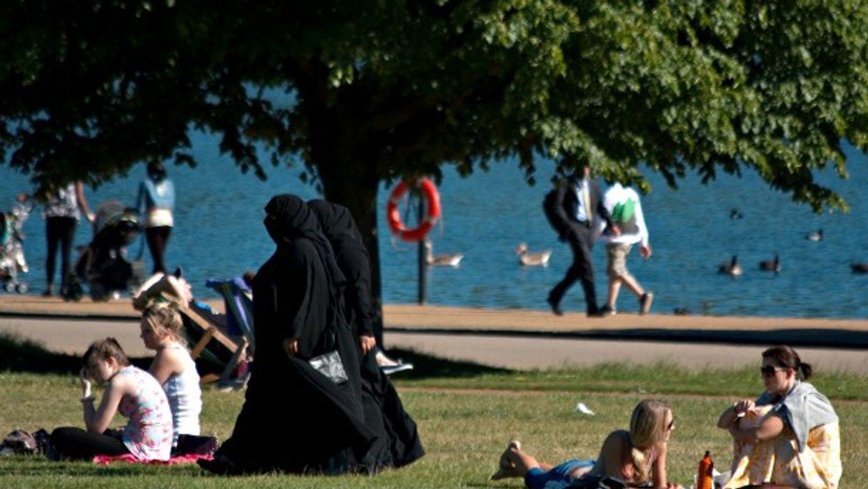 Two women wearing burqas in Hyde Park, London
