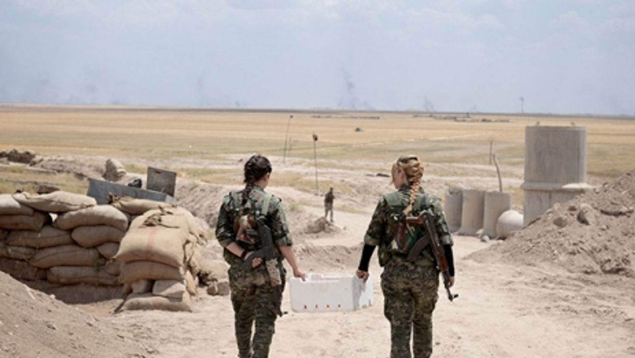 Two YPG fighters near al-Hasakah, Syria