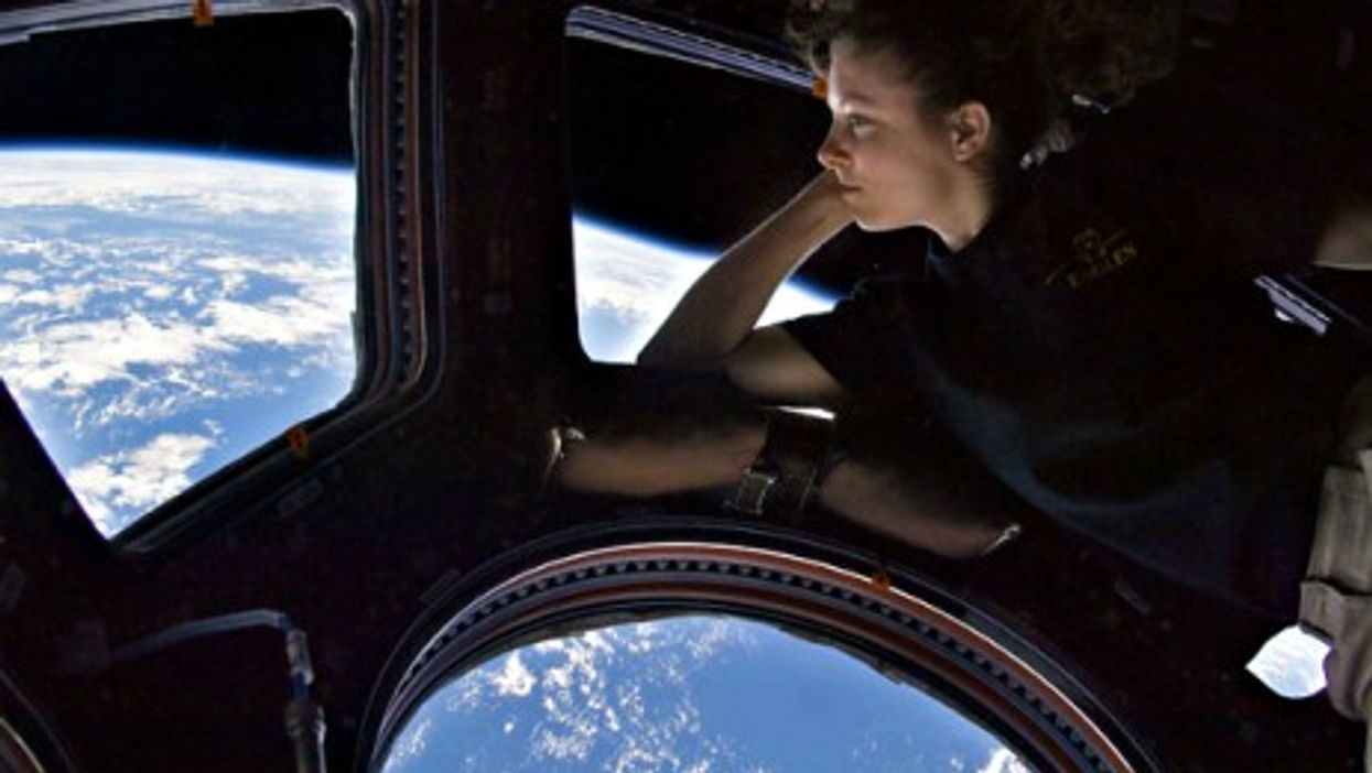 U.S. astronaut Tracy Caldwell Dyson looking out the ISS