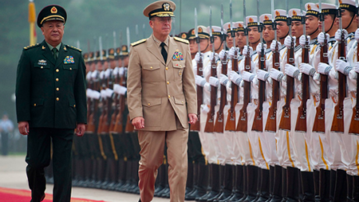 U.S. Chairman of the Joint Chiefs of Staff Adm. Mike Mullen arrives last year in Beijing.