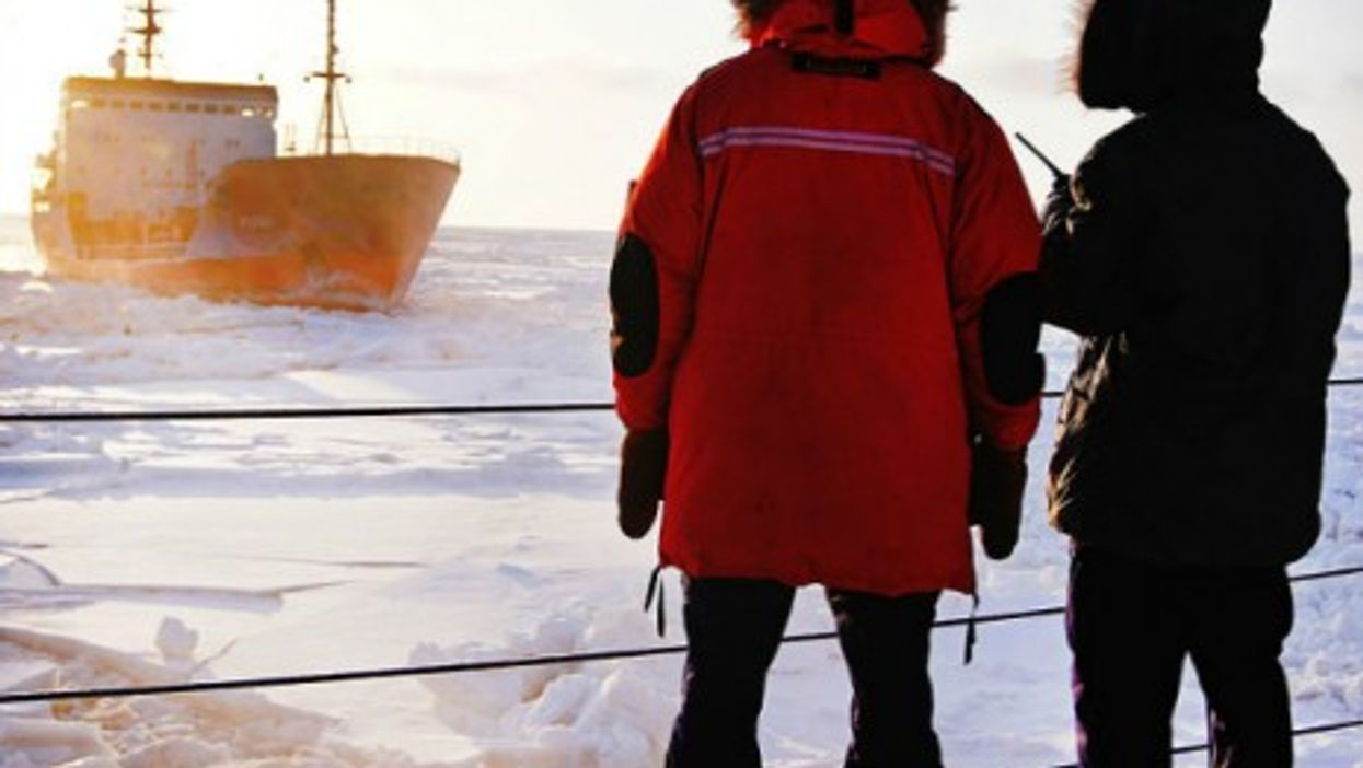 U.S. crew members observing a Russian tanker in the Arctic