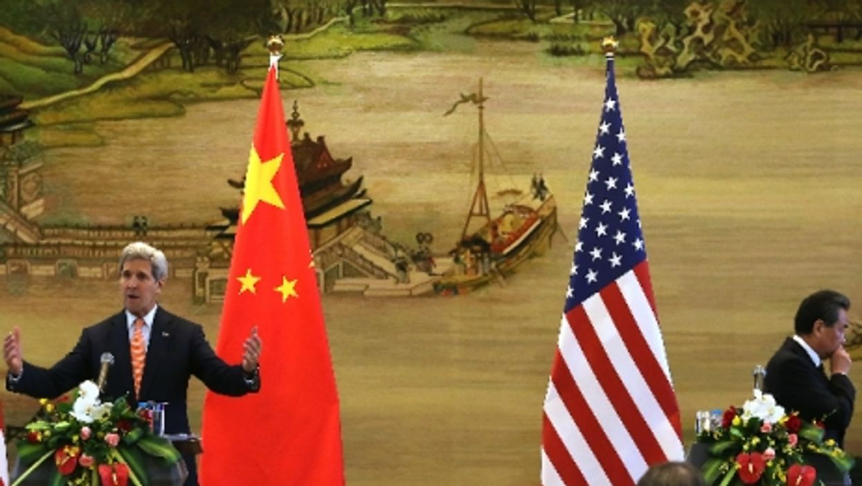 U.S. Secretary of State John Kerry and Chinese Foreign Minister Wang Yiin Beijing on May 16