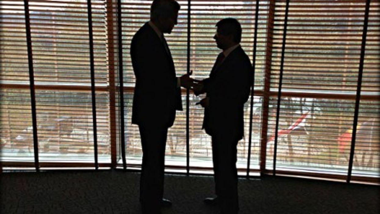 U.S. Secretary of State John Kerry and Turkey's Foreign Minister Ahmet Davutoglu in April 2013