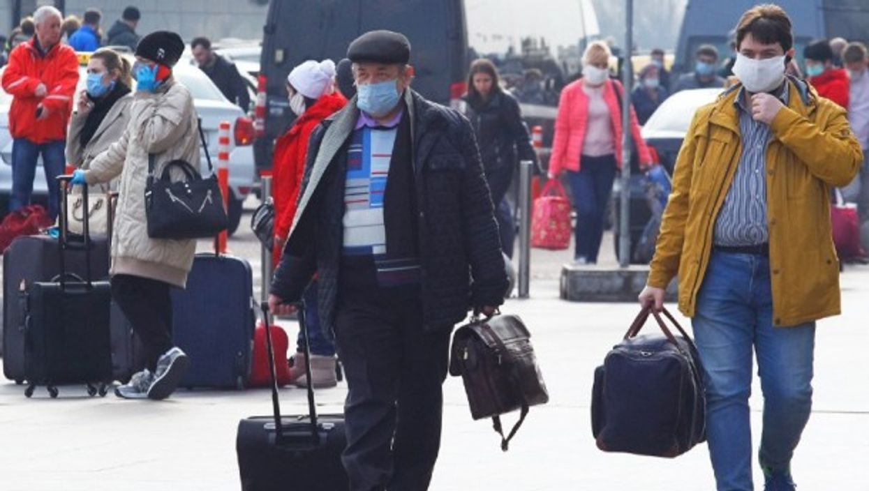 Ukrainian citizens from Russia walk at the central railway station in Kiev after the evacuation.