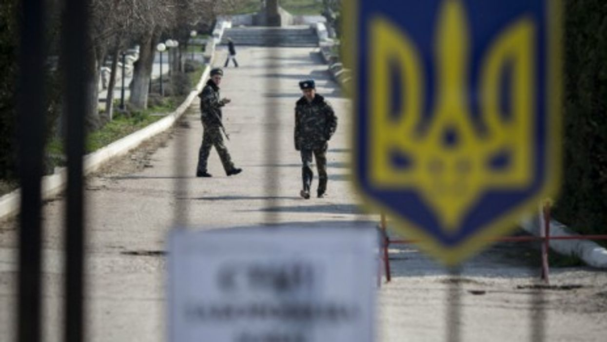 Ukrainian soldiers inside the Belbek military air base on March 16