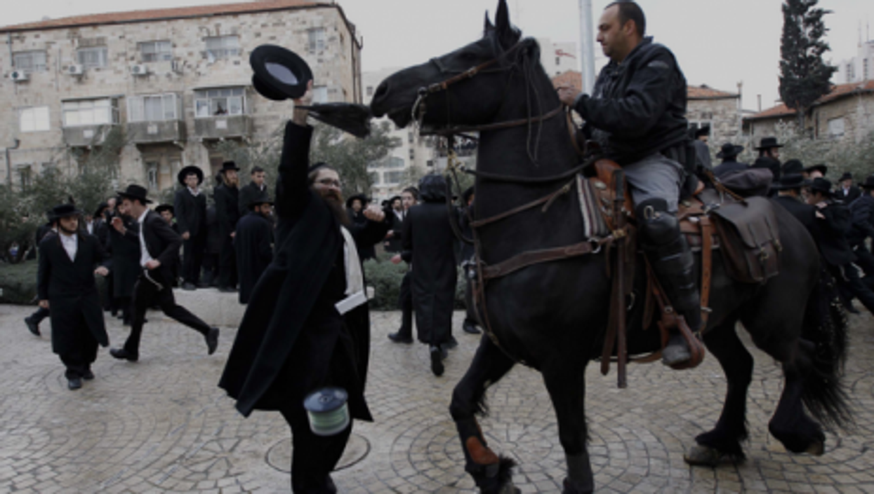 Ultra-Orthodox Jews in Israel protest cutting funds to seminary students who avoid military service.