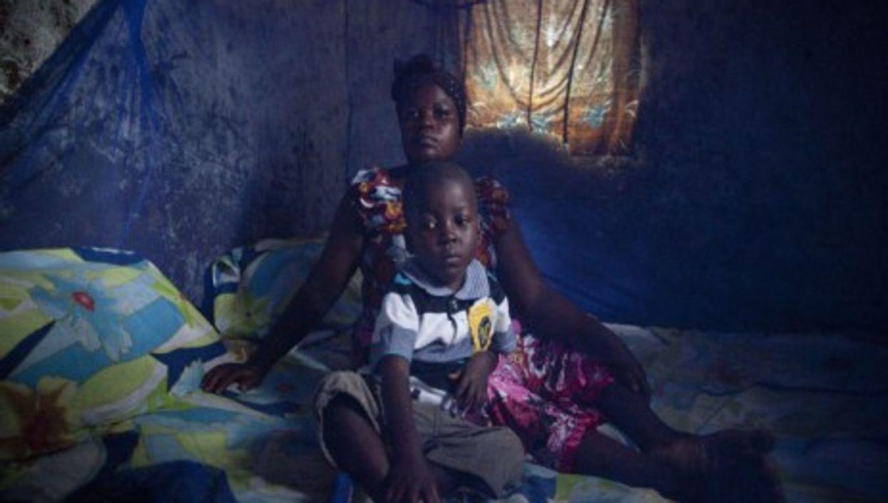Under the net: Zabibu Athumani and her son Abirai Mbaraka Sultani (Bill & Melinda Gates Foundation)
