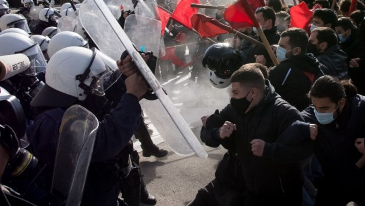 University students in Athens clash with police forces during a protest against a government bill that would allow the creation of a special campus police force and disciplinary councils in national universities.