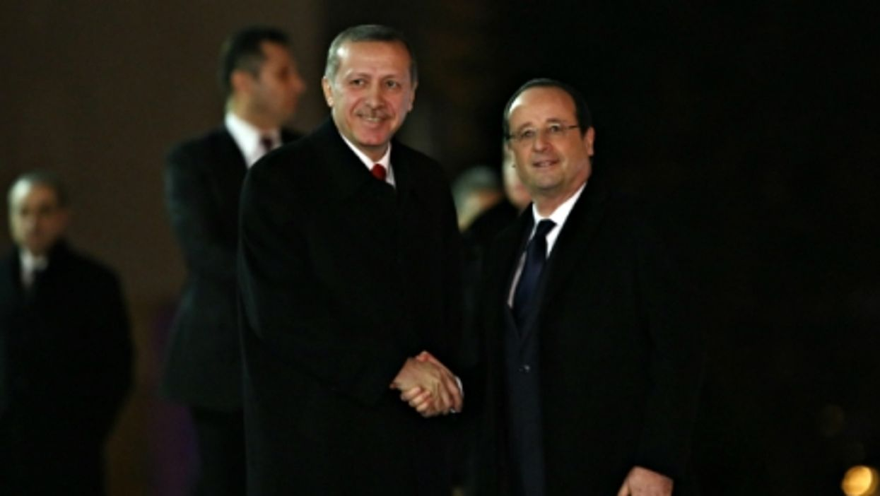 urkish PM Erdogan and French President Hollande in Ankara in 2014
