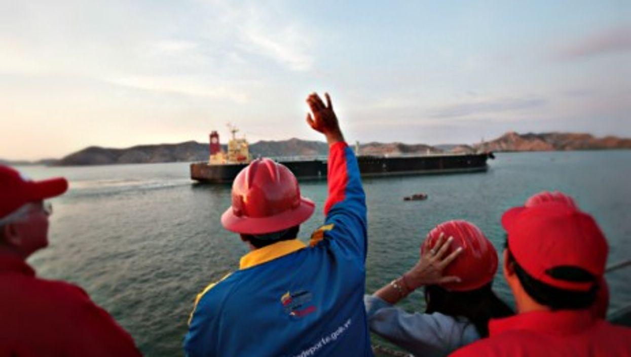 Venezuelan President Nicola Maduro waving at an oil tanker