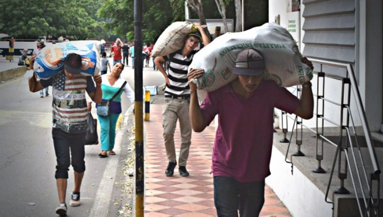Venezuelans carry food across the Colombian border last December.