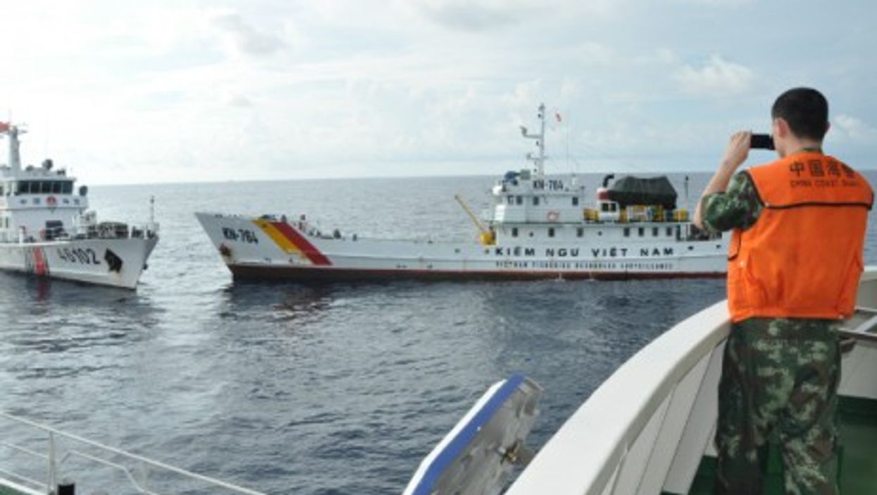 Vietnam marine surveillance ship attempts to intrude a Chinese company's work zone and ram with China Coast Guard ship in South China Sea